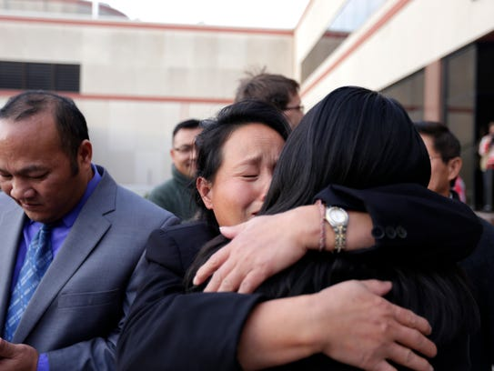 Dylan Yang supporters embrace and try to comfort one