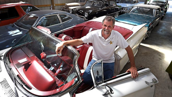 David Tinsley poses with a 1960 Buick LaSabre at Ragtop Picture Cars in Lebanon, Tenn. Ragtop owns about 130-150 classic automobiles he restores that are used for films, commercials and more than 2,000 music videos.