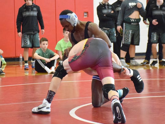Robert E. Lee's Ta' Strother, top, will try to earn