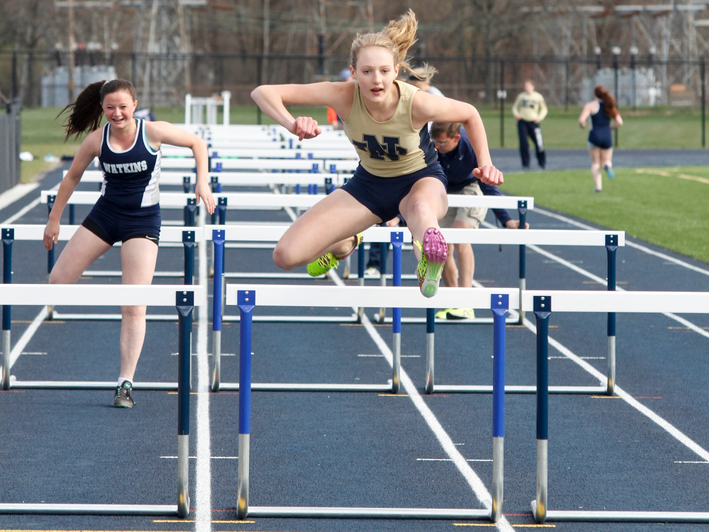 Notre Dame athlete Laurel Karee beats out her Watkins Glen competitor Tuesday at a home invitational.