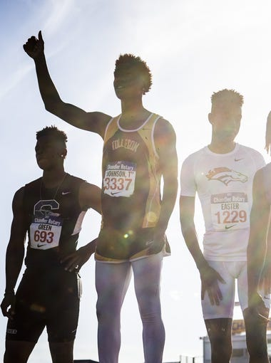 Tolleson's Trey Johnson (center) celebrates winning the 100 meter hurdles during the Chandler Rotary Classic at Chandler High School on March 25, 2017 in Chandler, Ariz.