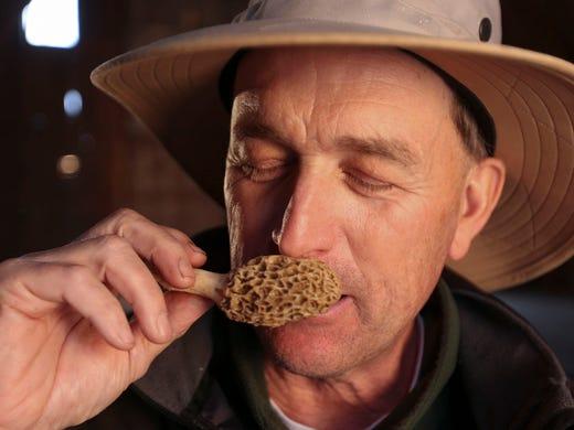 Greg Rinehart of Rinehart's Family Farm, takes a whiff