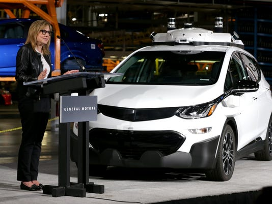 GM CEO Mary-Barra with autonomous Chevrolet Bolt