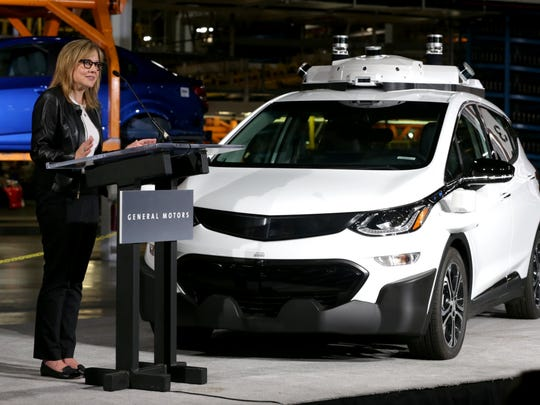 GM Chairwoman and CEO Mary Barra talks with workers