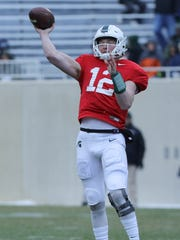 Michigan State quarterback Rocky Lombardi passes during