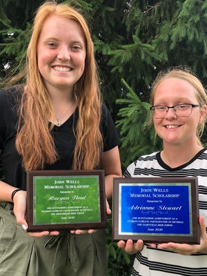 John Wells Memorial Scholarship winners Reagan Flood of Shenandoah High School, left, and Adrianne Stewart of Zanesville High School are shown with their plaques.