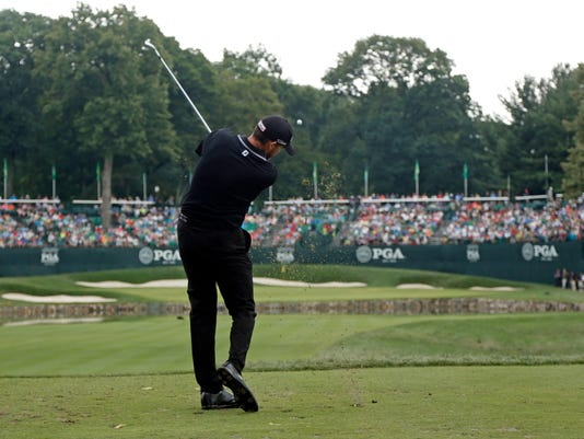 Jimmy Walker hits his tee shot on the fourth tee during the final round of the PGA Championship golf tournament at Baltusrol Golf Club in Springfield, N.J., Sunday, July 31, 2016. (AP Photo/Mike Groll)