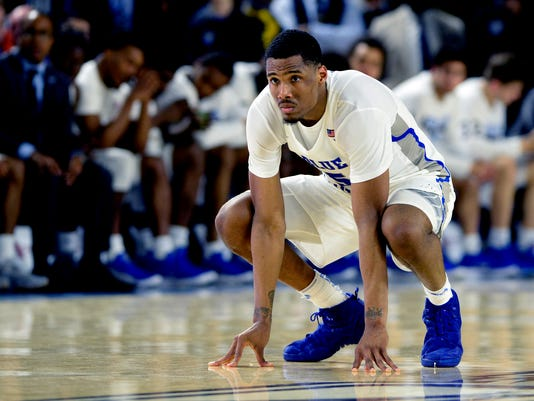 Middle Tennessee forward Nick King kneels as he watches a Marshall player shoot a free throw during the second half of an NCAA college basketball game Saturday, March 3, 2018, in Murfreesboro, Tenn. Marshall won 76-67. (AP Photo/Mark Zaleski)