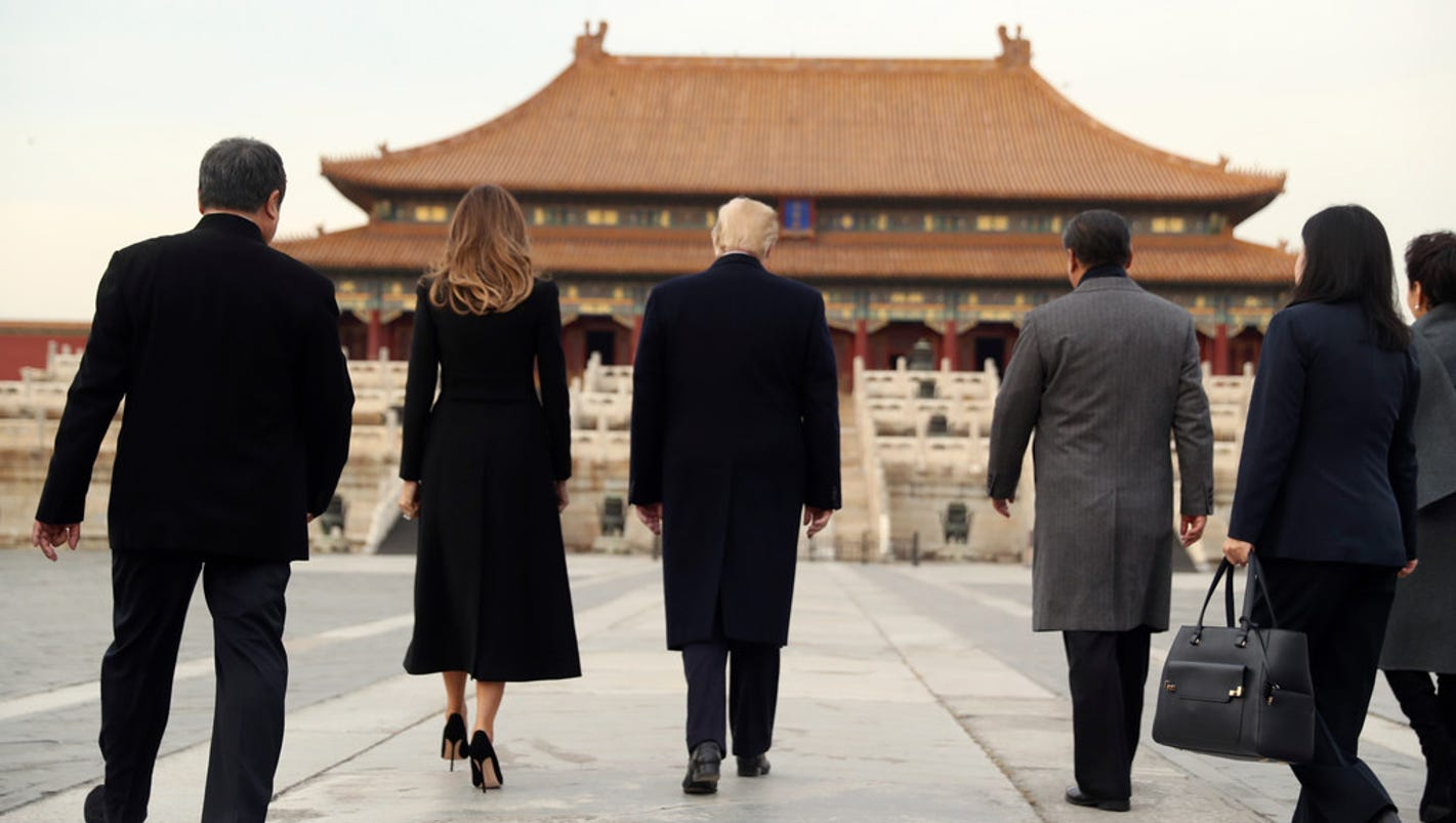 Trump arrives in China for talks on trade and North Korea