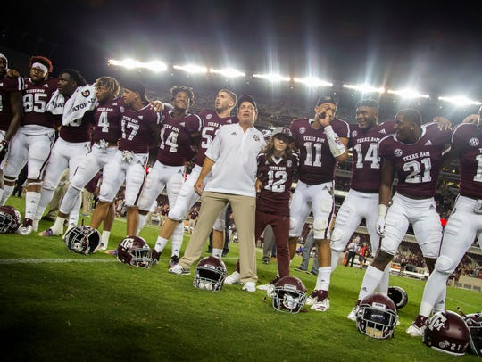 Texas A&M coach Jimbo Fisher lines up with his team
