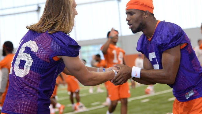 Clemson quarterback Trevor Lawrence (16) and quarterback Kelly Bryant (2) during the first day of practice at the Clemson Indoor Football facility at Clemson on Friday, August 3, 2018.