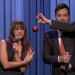 """Jimmy Fallon brought the holiday spirit Thursday night when he and """"Parks and Recreation"""" star Rashida Jones gave fans the gift of parodying pop hits by Ariana Grande, Sam Smith and Nicki Minaj, among others."""