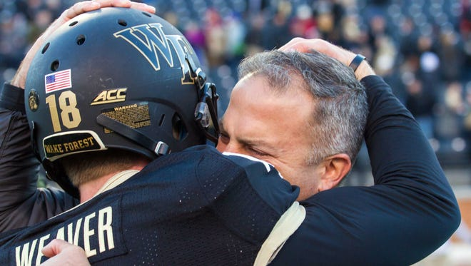 Wake Forest kicker Mike Weaver celebrates with special teams coordinator Adam Scheier after kicking the winning field goal in overtime.