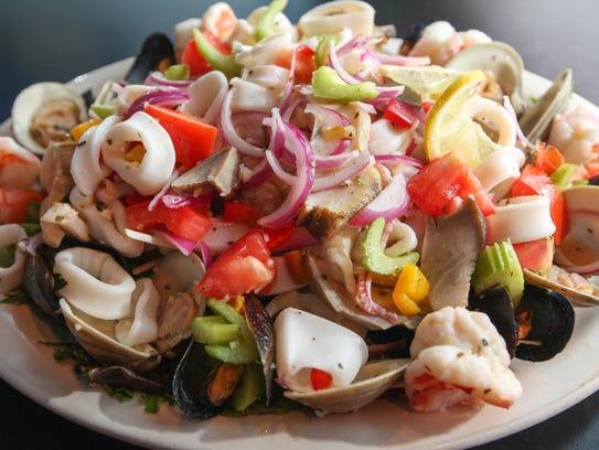 Seafood salad, (mussels, clams, calamari, scungilli