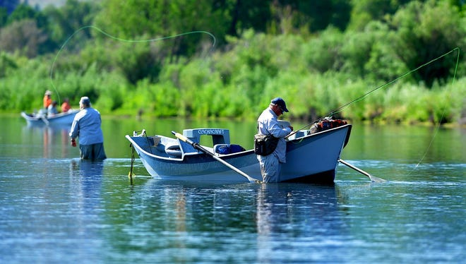 Anglers fly-fish the Missouri River just below Craig on Thursday morning.