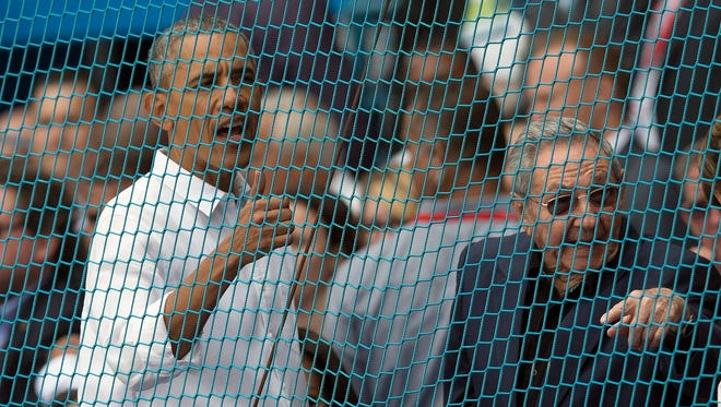 Cuban President Raul Castro, right, and U.S. President Barack Obama react to a baseball game between the Tampa Bay Rays and Cuba's national team in Havana, Cuba, Tuesday, March 22, 2016.