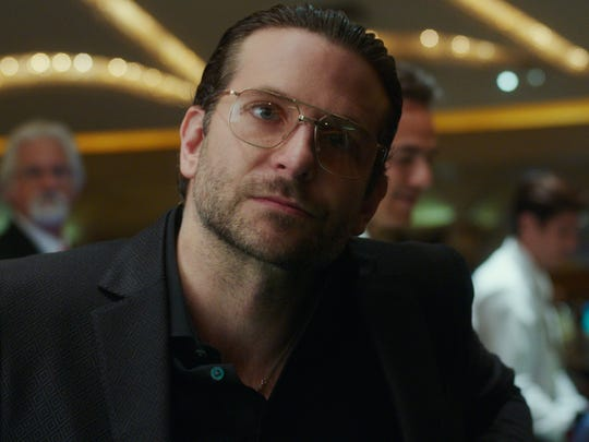 Bradley Cooper co-stars as a shady international weapons