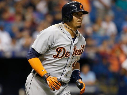 Tigers designated hitter Victor Martinez (41) hits a three-run home run during the seventh inning Friday in St. Petersburg, Fla.