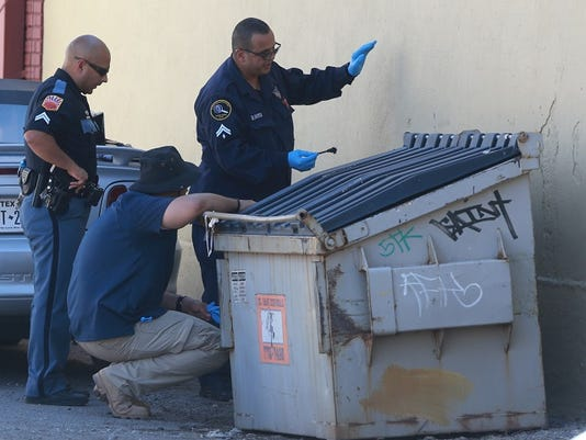El Paso officers investigate an incident in the alley between South Kansas and South Stanton and south of East Paisano Tuesday afternoon.