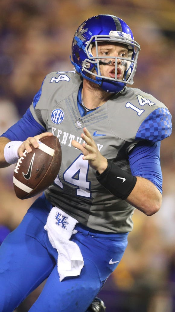 Oct 18, 2014; Baton Rouge, LA, USA; Kentucky Wildcats quarterback Patrick Towles (14) looks to pass the ball against the LSU Tigers in the first half at Tiger Stadium. Mandatory Credit: Crystal LoGiudice-USA TODAY Sports