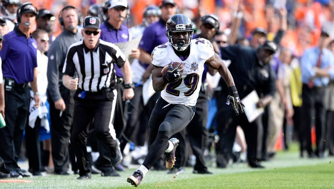 Sep 13, 2015; Denver, CO, USA; Baltimore Ravens running back Justin Forsett (29) carries the ball in the fourth quarter against the Denver Broncos at Sports Authority Field at Mile High. The Broncos won 19-13. Mandatory Credit: Ron Chenoy-USA TODAY Sports ORG XMIT: USATSI-224472 ORIG FILE ID:  20150913_ads_ac4_038.JPG