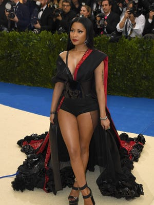 No pants, no problem. Nicki Minaj showed some leg in an H&M gown on the Met Gala carpet.