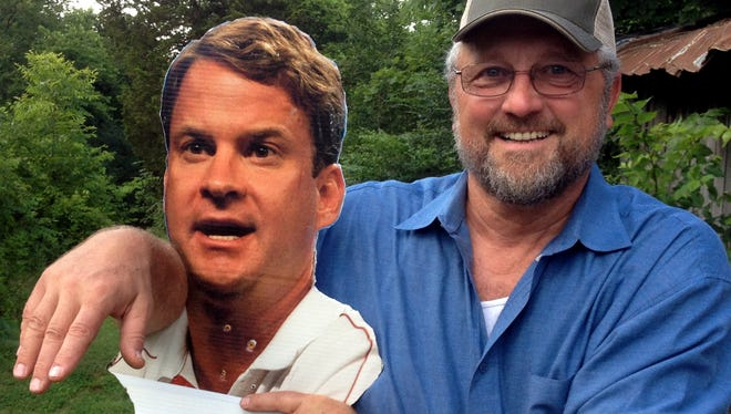 Dave Kelly and his Lane Kiffin scarecrow.