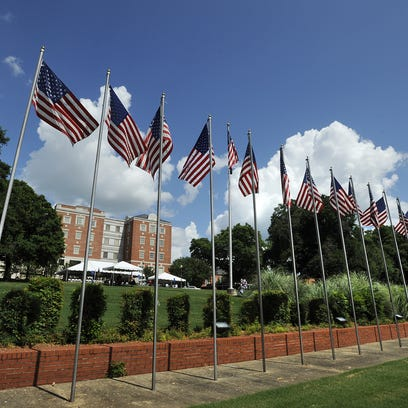 American flags fly at the west campus of the Central