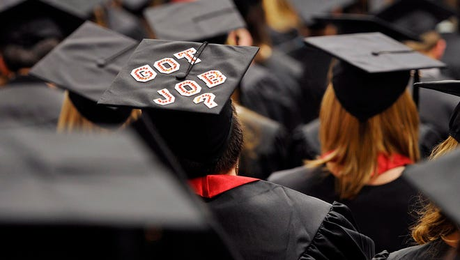 A graduating student's decorated mortarboard stands out during  commencement ceremonies at Edinboro University of Pennsylvania in 2012.