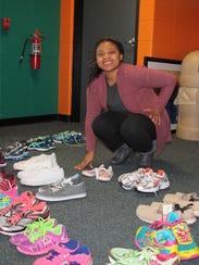 Silver Lake College student Edquitta Alexander helps