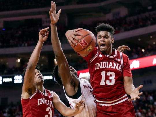 FILE - In this Feb. 20, 2018, file photo, Indiana's Juwan Morgan (13) and Justin Smith (3) vie for a rebound with Nebraska's Jordy Tshimanga, center, during the first half of an NCAA college basketball game in Lincoln, Neb. Morgan bypassed the NBA draft after producing his breakout season and returns as the veteran leader.  (AP Photo/Nati Harnik)