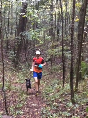 Tim Buchholz the adventure racer and Mick the Australian cattle dog jog along the Plover River segment of the Ice Age Trail.