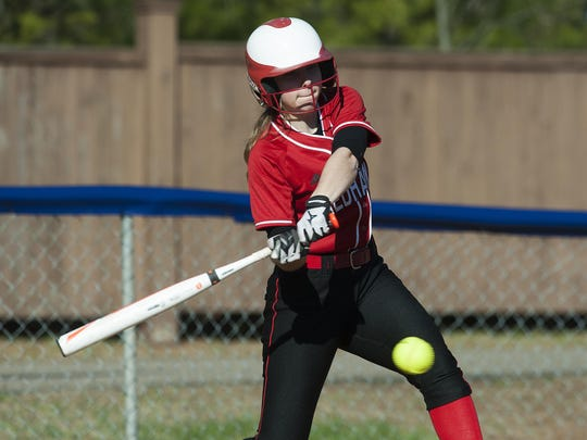 CVU's Paige Niarchos hits the ball during a high school softball game in Colchester.