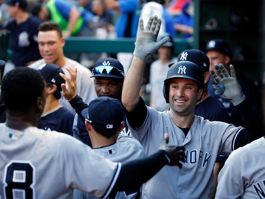 New York Yankees Neil Walker (14) celebrates his solo home run against the Texas Rangers during the third inning of a baseball game Wednesday, May 23, 2018, in Arlington, Texas.