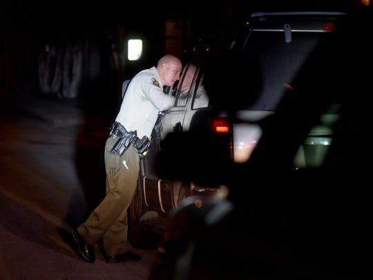 Ventura County Sheriff's Deputy Scott Baxter speaks with occupants of an SUV during a traffic stop in Saticoy.