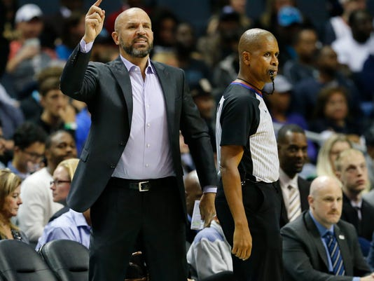 Milwaukee Bucks head coach Jason Kidd instructs his players while facing the Charlotte Hornets during the first half of an NBA basketball game, Wednesday, Nov. 1, 2017, in Charlotte, N.C. (AP Photo/Jason E. Miczek)