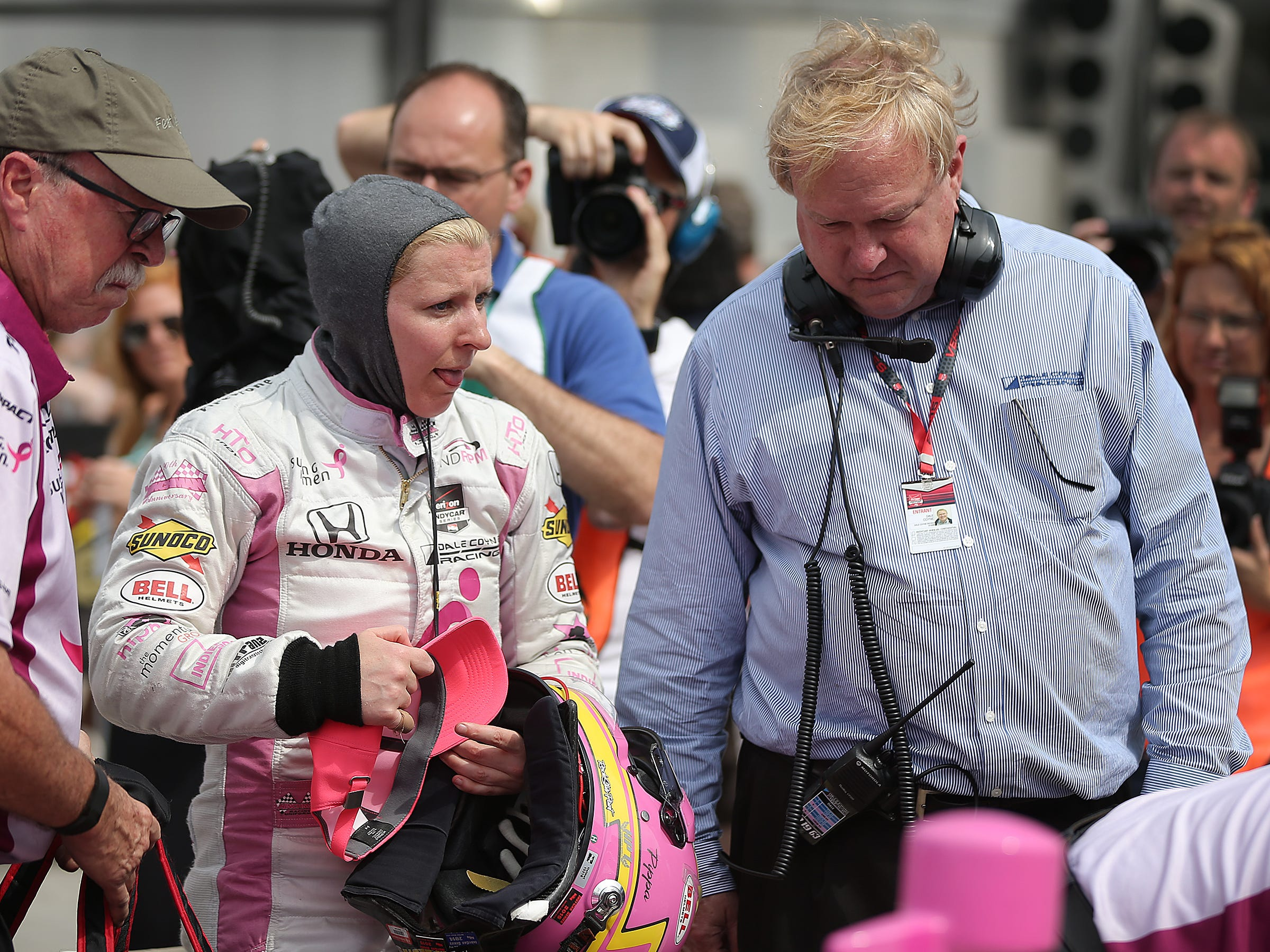 Dale Coyne RacingÕs Pippa Mann (63) talks with team over Dale Coyne following her qualifications attempts for the 99th Indianapolis 500 Sunday, May 17, 2015, morning at the Indianapolis Motor Speedway.