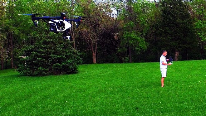 Flying on private property near Solon, Miller tests a DJI Inspire 1 drone, using another drone to take this photo.