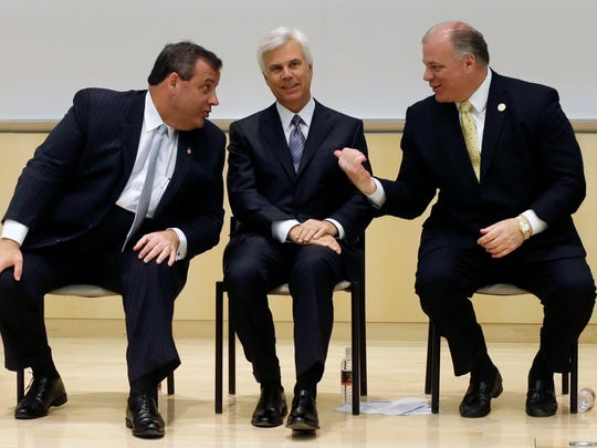 New Jersey Senate President Stephen M. Sweeney, D-Camden, right, gestures as New Jersey Gov. Chris Christie, left, talks with influential Democrat George E. Norcross III, at a 2014 groundbreaking ceremony in Camden for the KIPP Cooper Norcross Academy school that Norcross' family foundation will help fund.