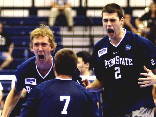 Penn State's Max Holt, left, Kevin Wentzel (7) and Dan O'Dell (2) celebrate the last point of their second-game win over UC Irvine during the NCAA men's volleyball championship semifinals in State College, Pa, Thursday, May 4, 2006.