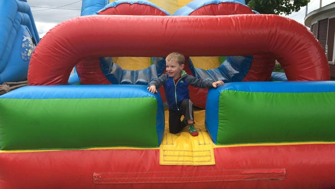 Kai Arisman, 4, Marshfield, enjoys the inflatables attractions Saturday at Marshfield Dairyfest Family Fun Day.