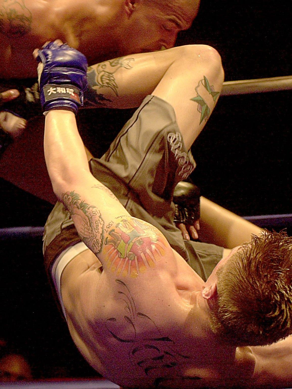 Josh Smith kicks a charging Justin Mercado during their