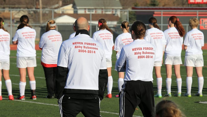 Members of the Livonia Churchill girls soccer team wore shirts during pre-game warm-ups that paid tribute to 9-year-old Abby Rubenson, whose passed away in July. Liz Rubenson, Abby's sister, is a sophomore defender for the Chargers.
