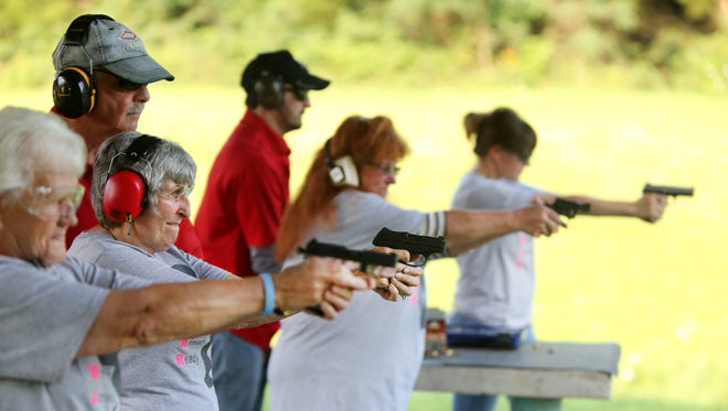 """Members of the 'Women Armed and Ready' gun club take target practice at the Laughery Valley Fish and Game Shooting Range in Versailles. The new club was started by Konnie Couch and Robin Willoughby in May. Giving instruction are Dale Reatherford, owner of Whitewater Valley Firearms Training and part-time Springdale police officer, left, and Brandon Vornauf, one of the firearms trainers. Barb Maness, 75, second from left, uses a Ruger LCP 380. She has her Indiana concealed-carry license and is getting her Florida concealed-carry license to allow her to carry in additional states. She said she wanted to learn to shoot for safety reasons after her husband passed away three years ago. She lives in rural Indiana. She said, """"I've been shooting for about two years. I'm surprised at how accurate I am."""""""