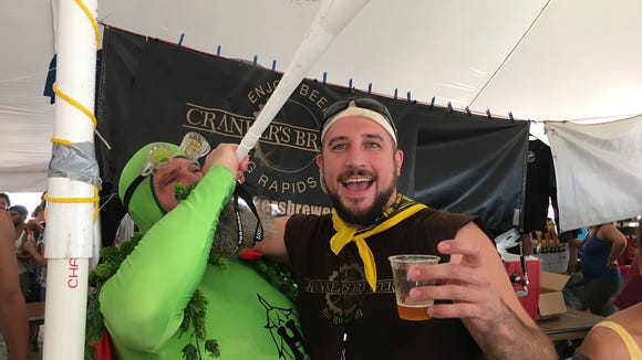 "Crankers' James Crank appears with ""Hop Man"" at the Michigan Brewers' Guild Summer Beer Festival."