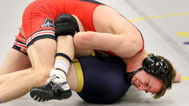 Muskego's Evan Sinda battles Kettle Moraine's John Crawford in a 145-pound match during the WIAA Division 1 New Berlin Sectional at New Berlin West on Feb. 17.