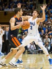 Duke's Grayson Allen (3) defends against Virginia's