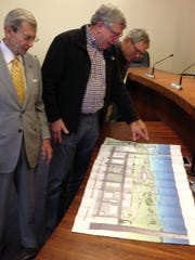 Alexandria City Councilmen (from left) Harry Silver, Lee Rubin and Jim Villard look over a  map of downtown Alexandria that highlights potential R.I.V.E.R. Act projects.