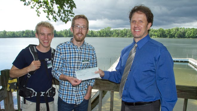 From left, Howell Conference and Nature Center camp counselor Dan Oswalt and program coordinator Matt Grant accept a check for $5,000 from Livingston Daily managing editor Jim Totten. Each year, the Livingston Daily's Camp Kid program solicits funds from the community to provide camp scholarships for children nominated for the program.Scholarships are granted to students in grades K-12 who live in Livingston County and have some sort of need, whether emotional or financial. A donation form  can be found on page 9A of today's paper.The Howell Conference and Nature Center partners with the Livingston Daily to offer scholarships to local children for summer camp. This program was started in 2000.