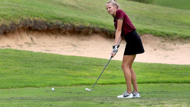 Buhler's Lauren Specht chips onto the first hole green during the Nickerson Invitational Tournament Monday at Crazy Horse Golf Course.